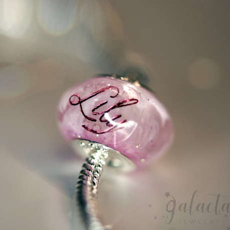 Personalized Pandora style bead with breastmilk and a pink name