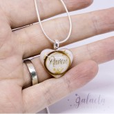 Heart shaped pendant made of breast milk with a lock of baby's hair