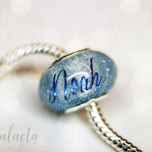 European charm bead with blue name and breastmilk