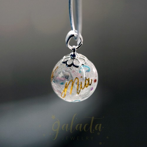 Personalized keepsake pendant with lock of hair, breast milk and a name