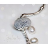 Personalized crystal bead with breast milk and a silver name