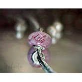 Personalized bead pendant with breastmilk and a pink name